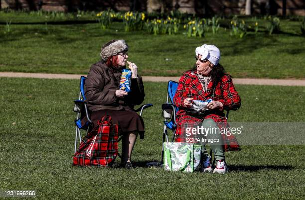 Two ladies seen having a picnic in St James' Park.