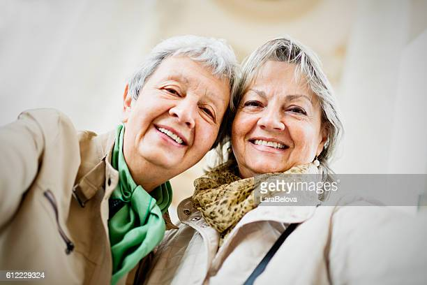 two ladies taking a selfie - only mature women stock pictures, royalty-free photos & images