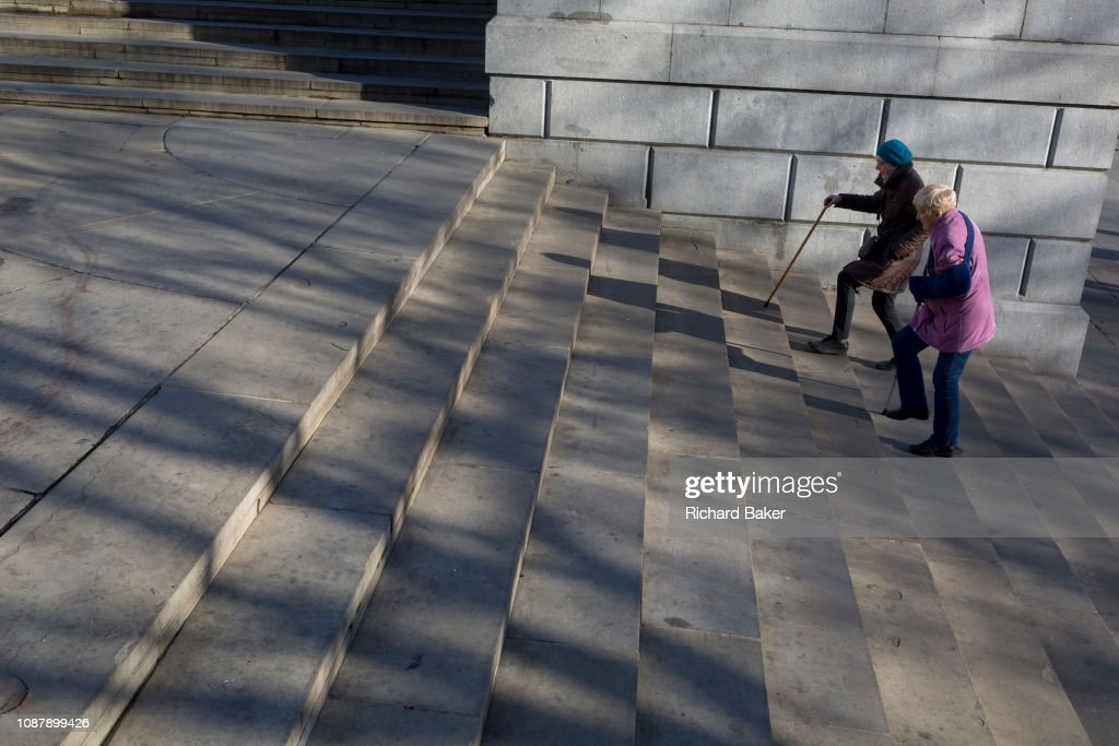 Ladies Struggling Up Steps : News Photo