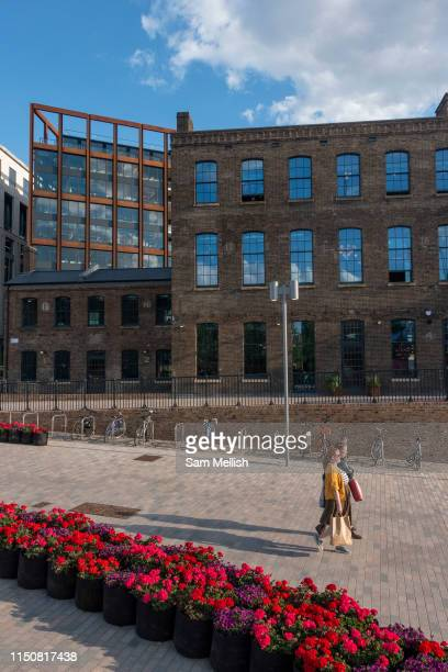 Two ladies walking at Granary Square on the 21st May 2019 in London in the United Kingdom On the banks of Regents Canal Granary Square is a public...