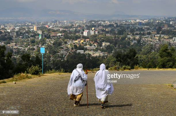 two ladies walking in addis ababa - addis ababa stock pictures, royalty-free photos & images