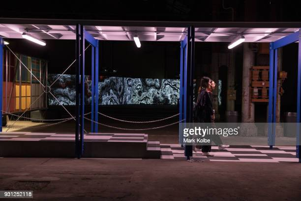 Two ladies walks through the art installation 'Classroom furniture for CS183Õ in Serene Velocity in Practice MC510/ CS183' by artist Michael...