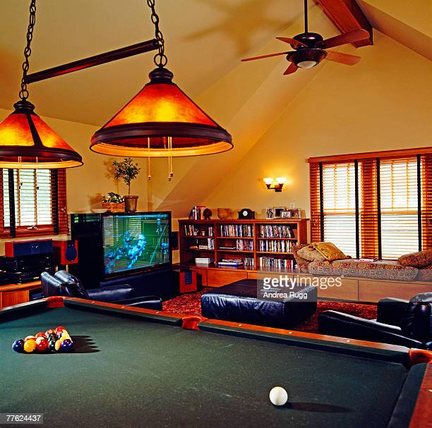 two lamps are hung above the pool table in the living room - man cave stock pictures, royalty-free photos & images