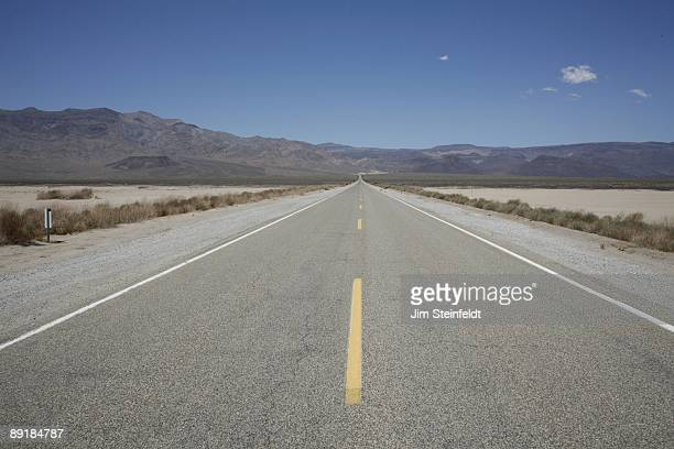 Two lane blacktop in Death Valley California on June 20 2009