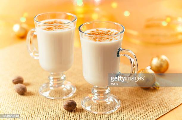 two large glasses of eggnog served beautifully - eggnog stock photos and pictures