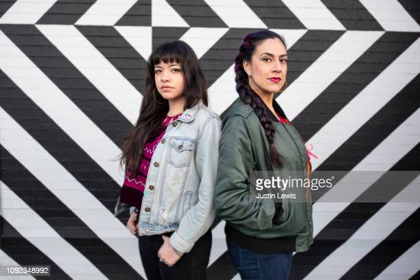 Two Latina Girlfriends Standing Together, Casual, Geometric Background