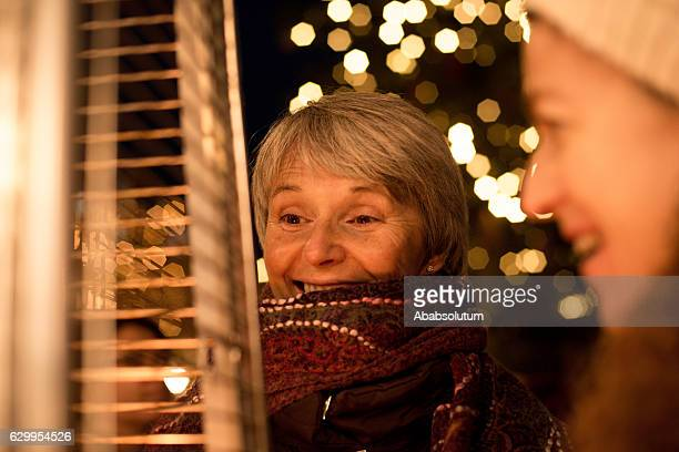 Two Laughing Female Friends and Fire, Night, Christmas, Carinthia, Austria
