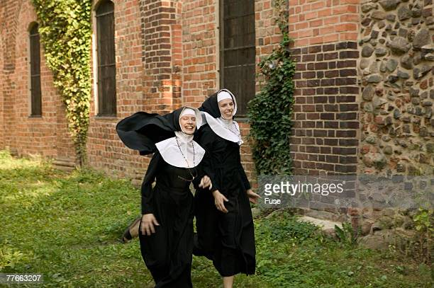 two laughing nuns in front of church - bonne soeur photos et images de collection