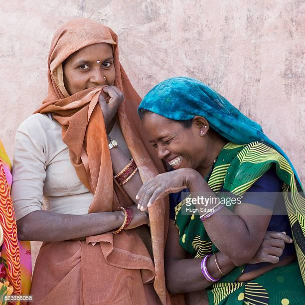 two laughing rajasthani women - hugh sitton stock pictures, royalty-free photos & images