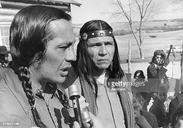 Two leaders of the American Indian Movement Russell Means and Dennis Banks appear grim after meeting with all the Indians at Wounded Knee South...