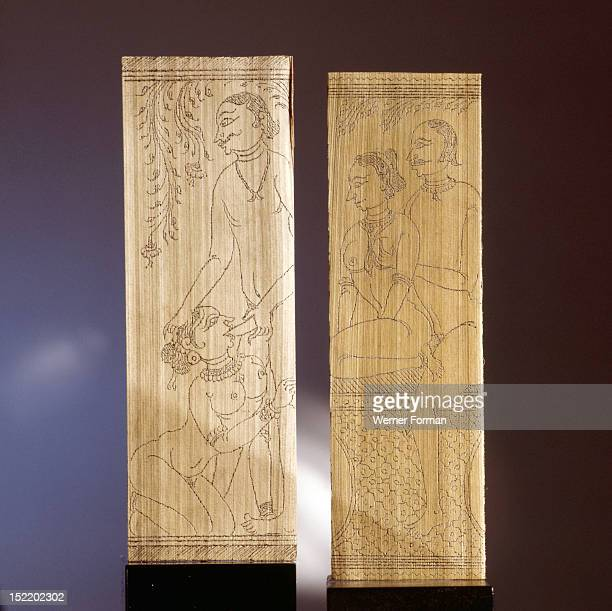 Two leaves of a palm leaf manuscript depicting erotic scenes One of the couples is engaged in the act of fellatio India Hindu 19th century Orissa
