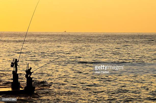 Two Lebanese fishermen at sunset in Beirut, Lebanon