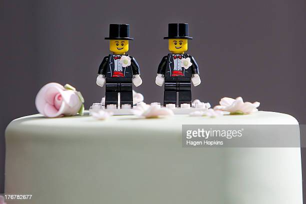 Two Lego men decorate the top of Paul McCarthy and Trent Kandler's wedding cake prior to the reception at Martin Bosley's on August 19 2013 in...