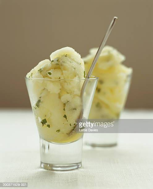 two lemon and mint sorbet desserts (focus on one with spoon) - sorbet stock pictures, royalty-free photos & images