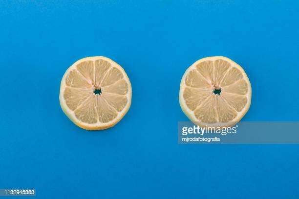 two lemon slices. - fruta stock photos and pictures