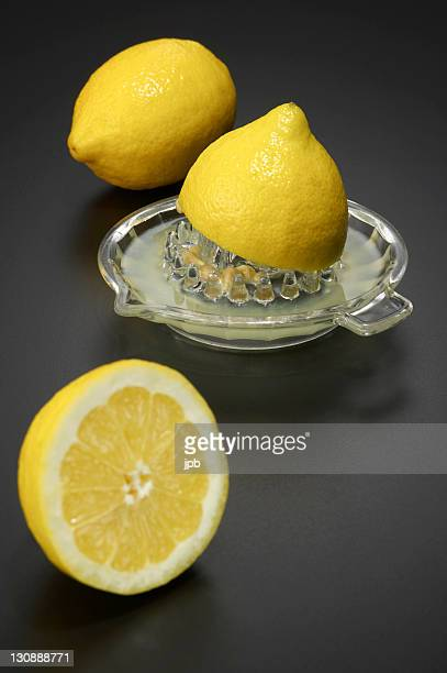 Two lemons with a squeezer made of glass