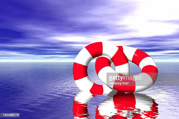 Two life buoys on the sea