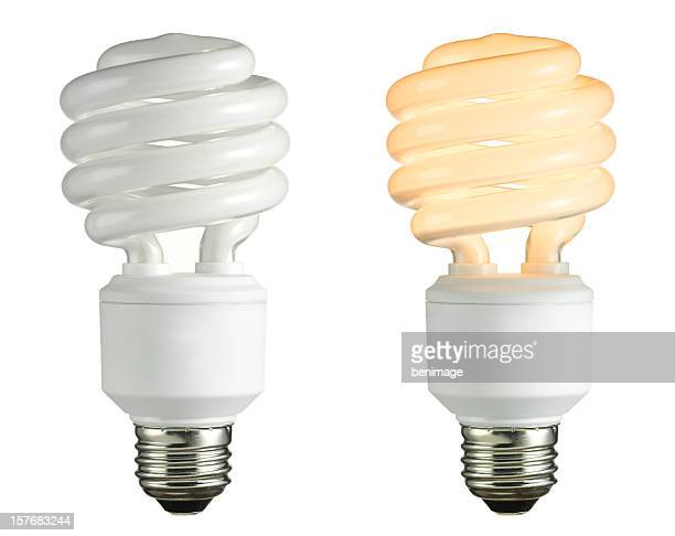 Two light bulbs on a white backdrop, one white and one warm