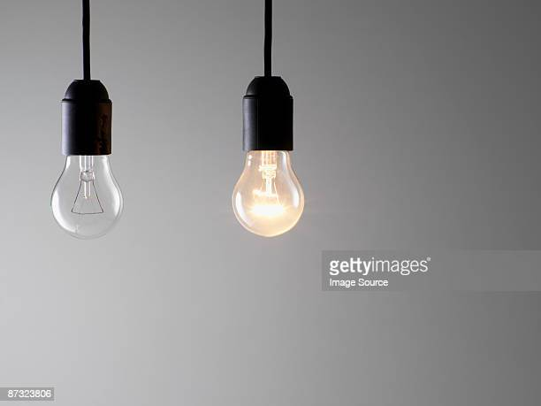 two lightbulbs - light bulb stock pictures, royalty-free photos & images