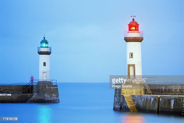 Two lighthouses at a port in belle ile