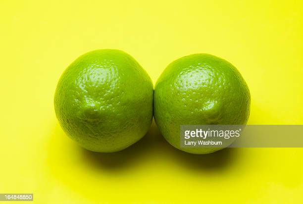 Two limes arranged to look like a pair of breasts