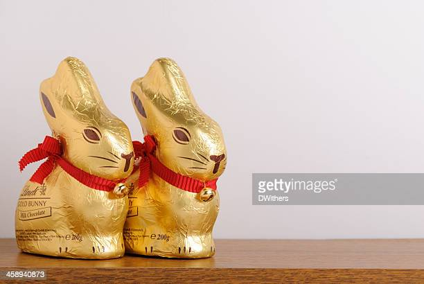 Two Lindt Easter Gold Bunnies on Shelf