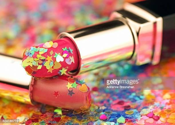 Two lipsticks and glitter