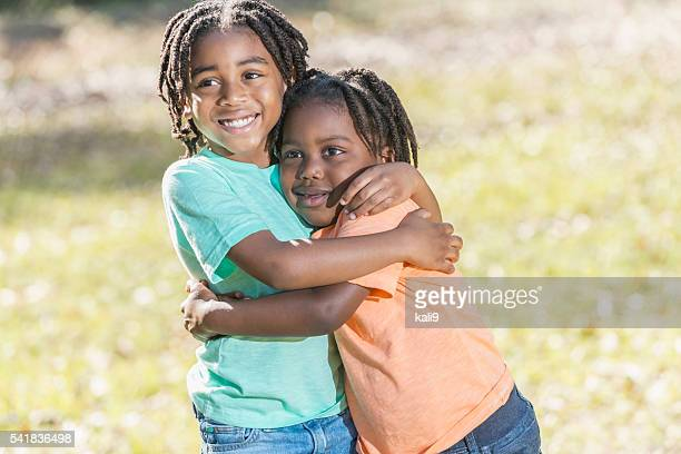 Two little African American boys hugging