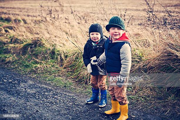 Two little boys out for a walk in the country