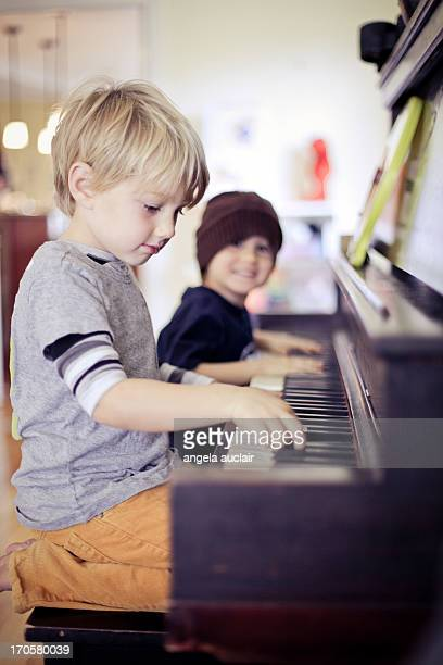 two little boys - plucking an instrument stock pictures, royalty-free photos & images