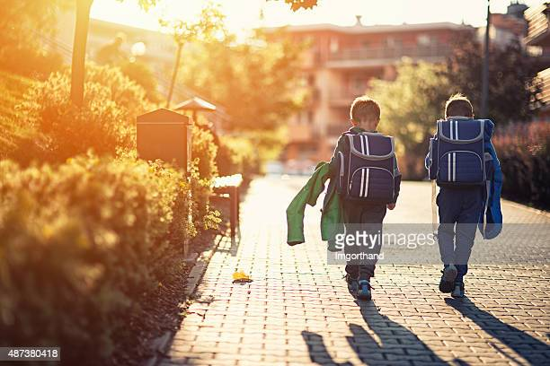 Two little boys returning from school