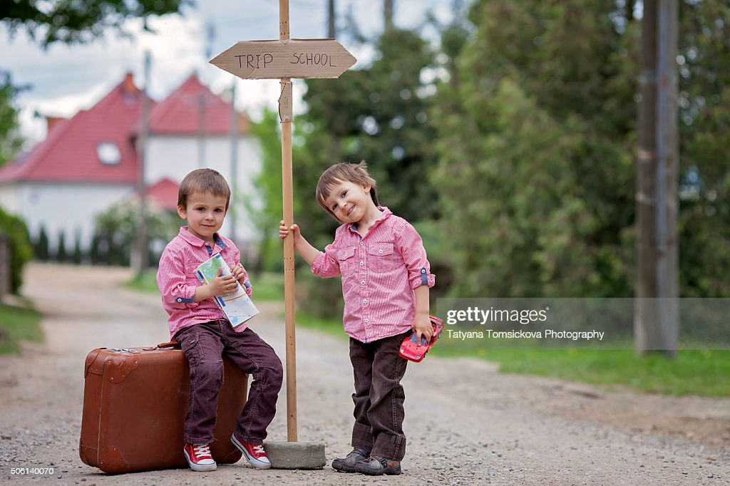 Two Little Boys With Suitcase Map And A Sign Choosing What To Do ...