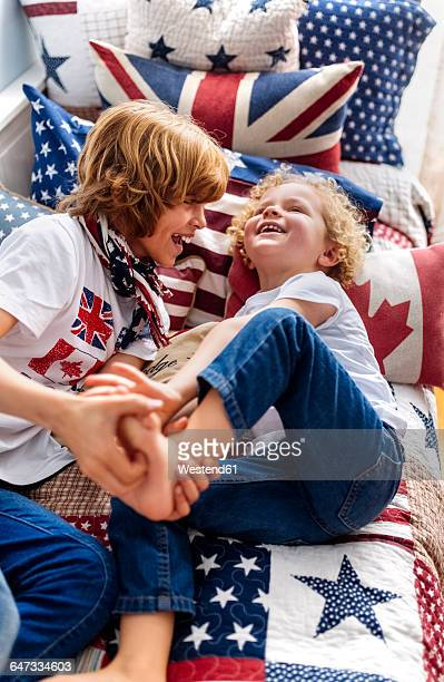 two little brothers playing together at home - fazendo cócegas - fotografias e filmes do acervo