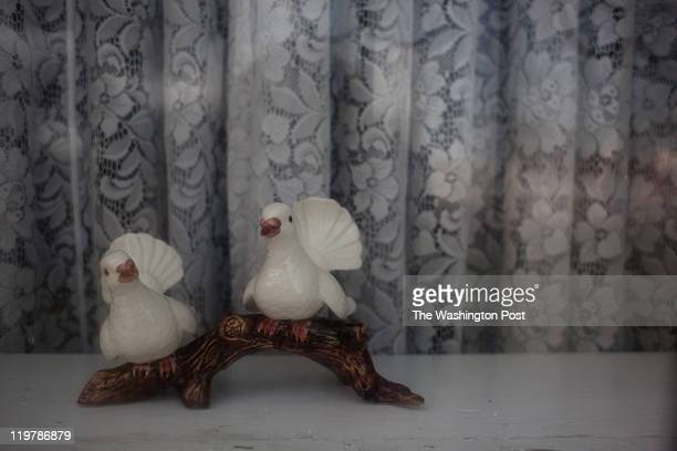 Two little ceramic birds are seen in the window of Kent and XXX Romney's home in Colonia Juarez Mexico in July 2011 United States Presidential...