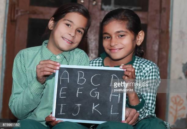 Two Little Girl Portrait with chalkboard