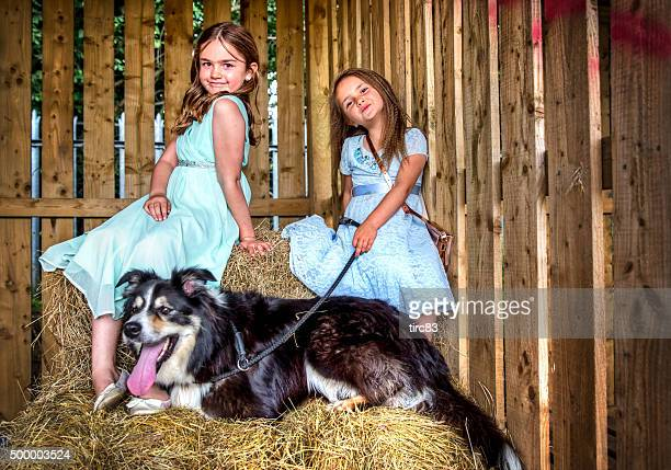 Two little girls and their dog