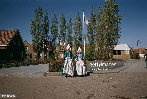Two little girls in Dutch costume in Volendam Netherlands circa 1965