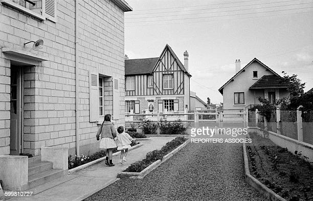 Two Little Girls Leaving Their House in the Small Norman City of Ouistreham, France, on June 24, 1963 .