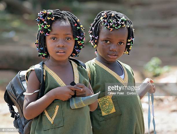 Two little girls on their way to school in Freetown