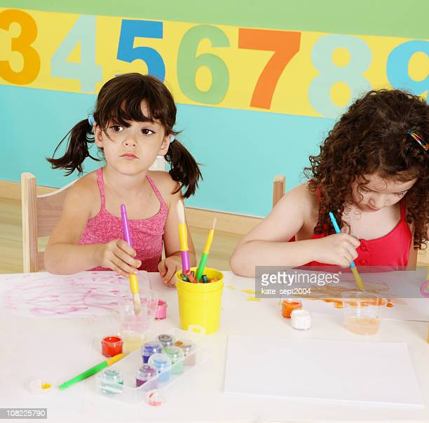Two Little Girls Painting