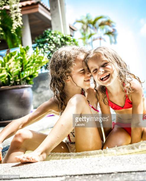 two little girls playing in the pool - cute little asian girls stock photos and pictures
