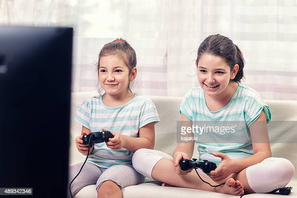 Two Little Girls Playing Video Games
