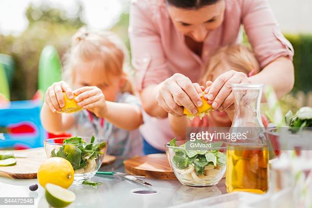 Two Little Girls Preparing Fresh Smoothies Outside