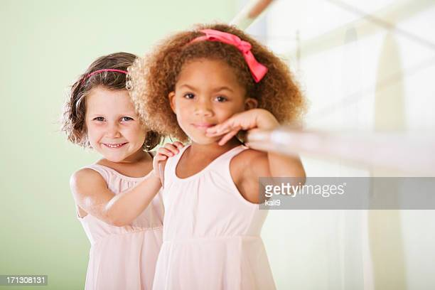 Two little girls smiling at the camera
