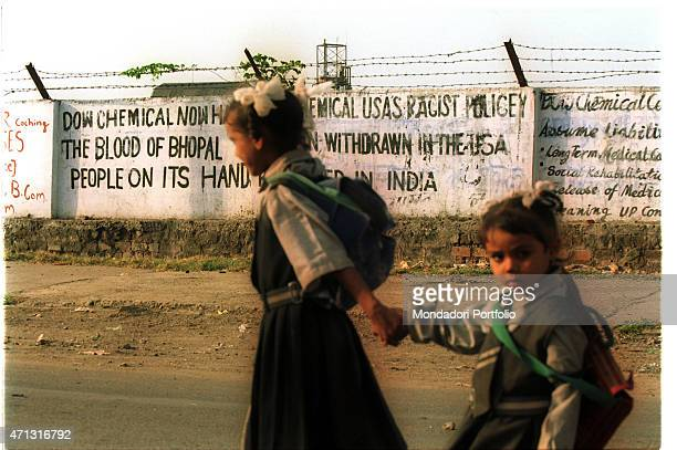 Two little girls walking hand in hand along the walls of the Union Carbide India Limited chemical plant The city was hit on 2nd December 1984 by one...
