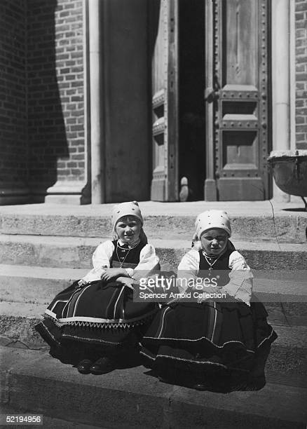 Two little Polish girls seated side by side circa 1915
