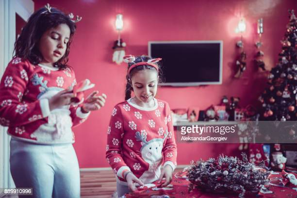 Two Little Sisters Decorating their Room for Christmas Holidays
