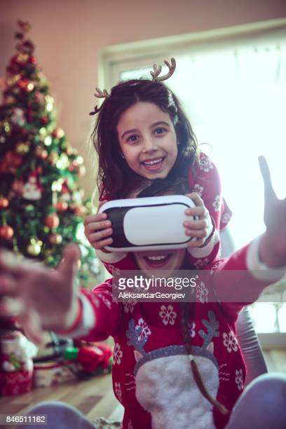 Two Little Sisters Playing and Fighting over Virtual Reality Simulator