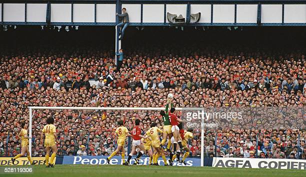 Two Liverpool fans climb up to get a better view of the action during the 1985 FA Cup semi final between Liverpool and Manchester United at Goodison...