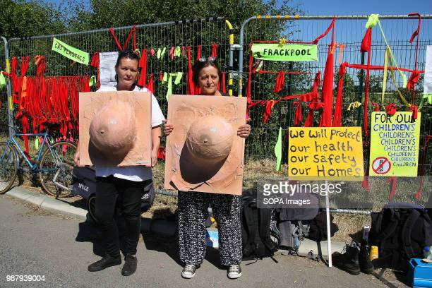 Two local Anti Frack Protesters hold imitation Breast Sculptures to highlight the claims that discharged waste Fracking Water causes breast cancer...